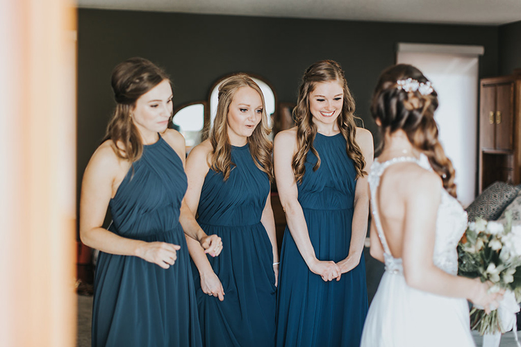 bride getting ready with bridsemaids - photo by Rivkah Photography http://ruffledblog.com/pacific-northwest-wedding-with-a-secret-waterfall