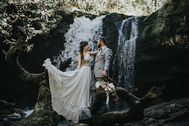 wedding portraits by waterfalls - photo by Rivkah Photography http://ruffledblog.com/pacific-northwest-wedding-with-a-secret-waterfall