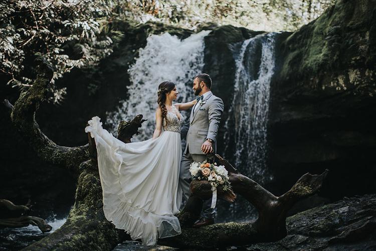 wedding portraits by waterfalls - photo by Rivkah Photography https://ruffledblog.com/pacific-northwest-wedding-with-a-secret-waterfall