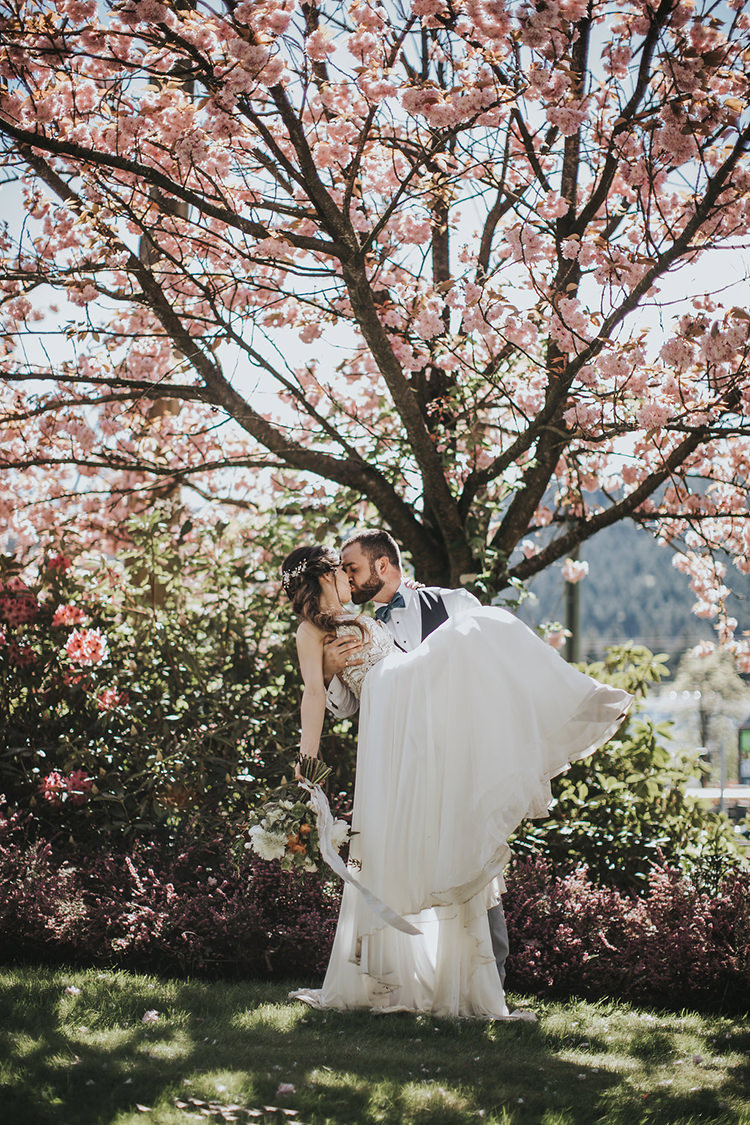 cherry blossom wedding portraits - photo by Rivkah Photography https://ruffledblog.com/pacific-northwest-wedding-with-a-secret-waterfall
