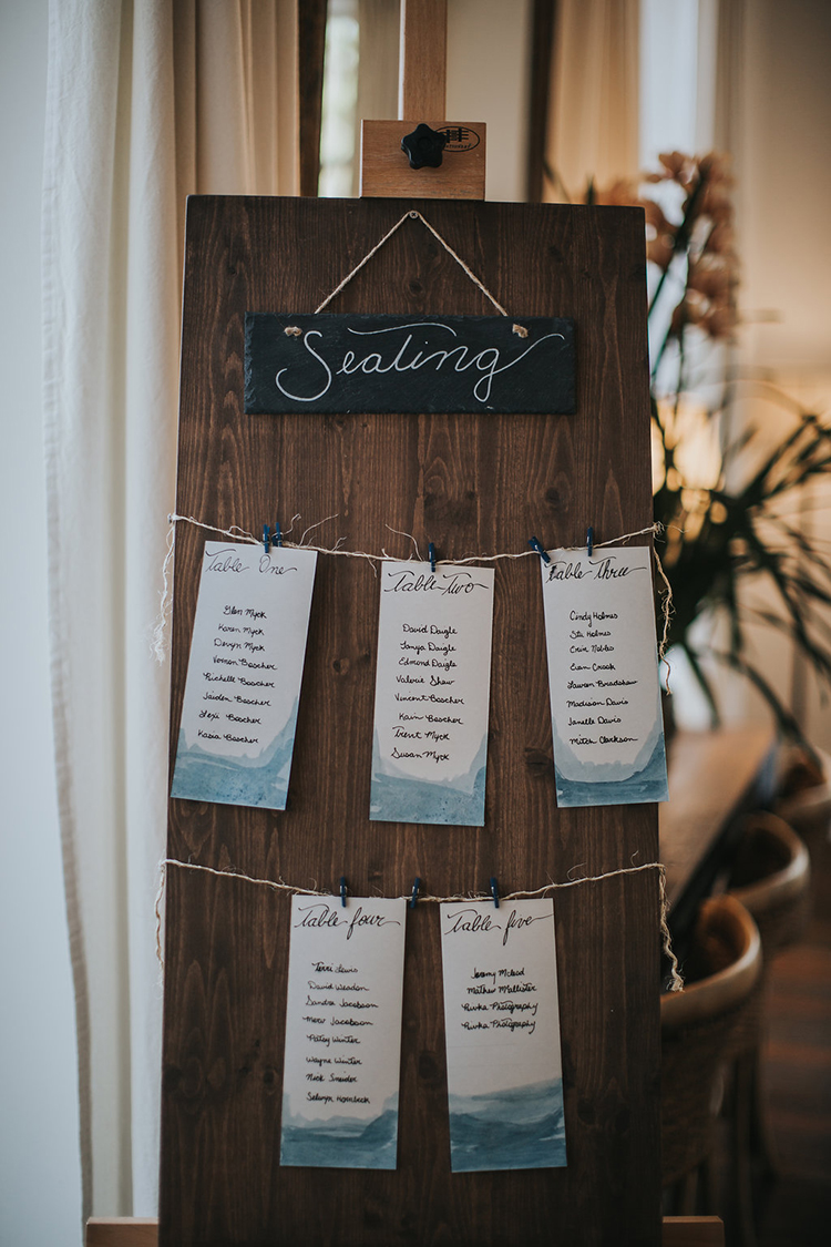 paper goods seating charts - photo by Rivkah Photography https://ruffledblog.com/pacific-northwest-wedding-with-a-secret-waterfall