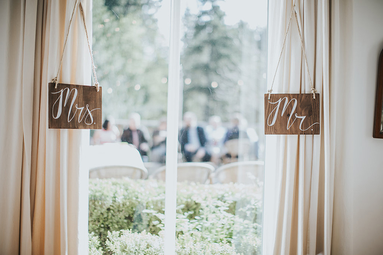 wedding signs - photo by Rivkah Photography http://ruffledblog.com/pacific-northwest-wedding-with-a-secret-waterfall