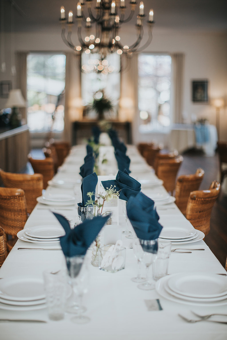 wedding tablescapes with blue napkins - photo by Rivkah Photography http://ruffledblog.com/pacific-northwest-wedding-with-a-secret-waterfall
