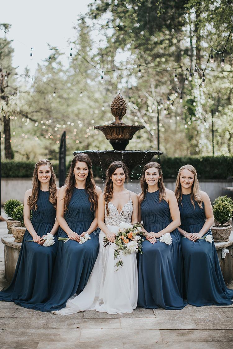 blue bridesmaid dresses - photo by Rivkah Photography https://ruffledblog.com/pacific-northwest-wedding-with-a-secret-waterfall