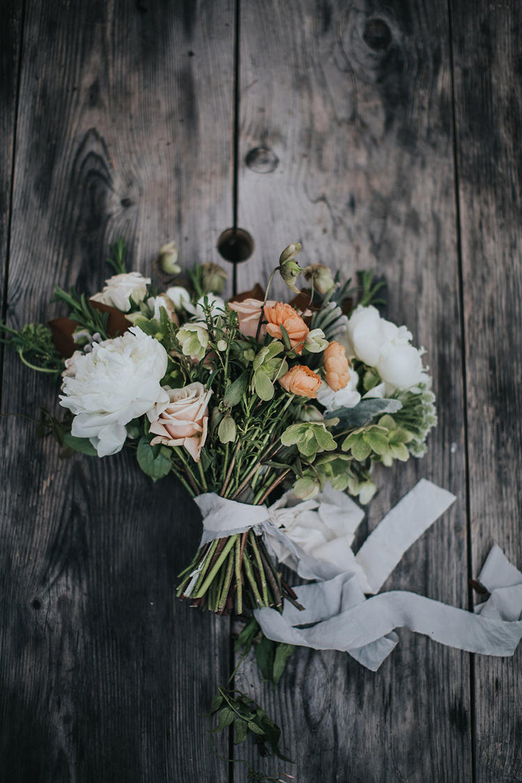 rustic inspired bouquets - photo by Rivkah Photography http://ruffledblog.com/pacific-northwest-wedding-with-a-secret-waterfall