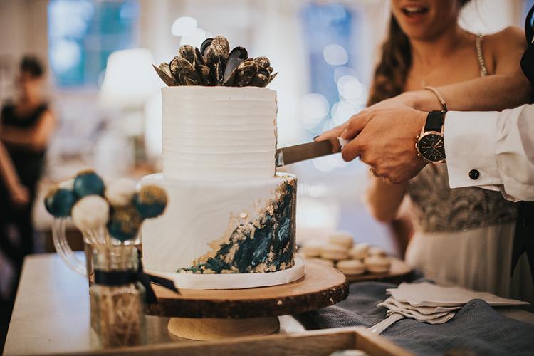 cake cutting - photo by Rivkah Photography http://ruffledblog.com/pacific-northwest-wedding-with-a-secret-waterfall