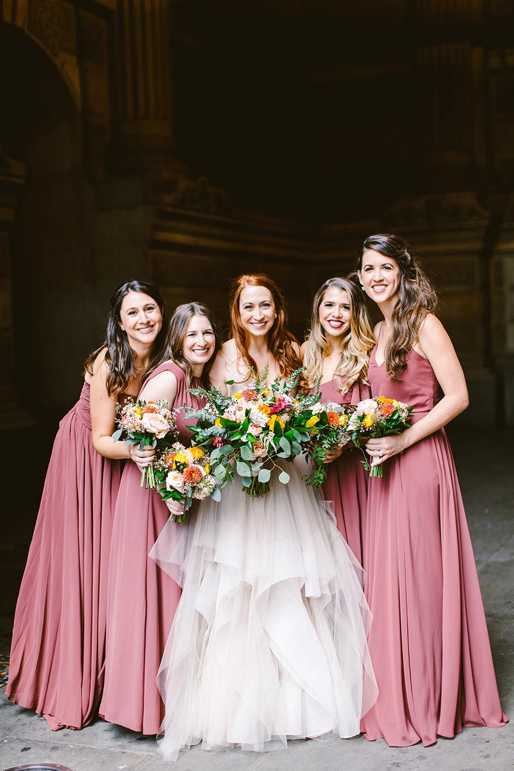 blush tulle wedding dress and mauve pink bridesmaid dresses