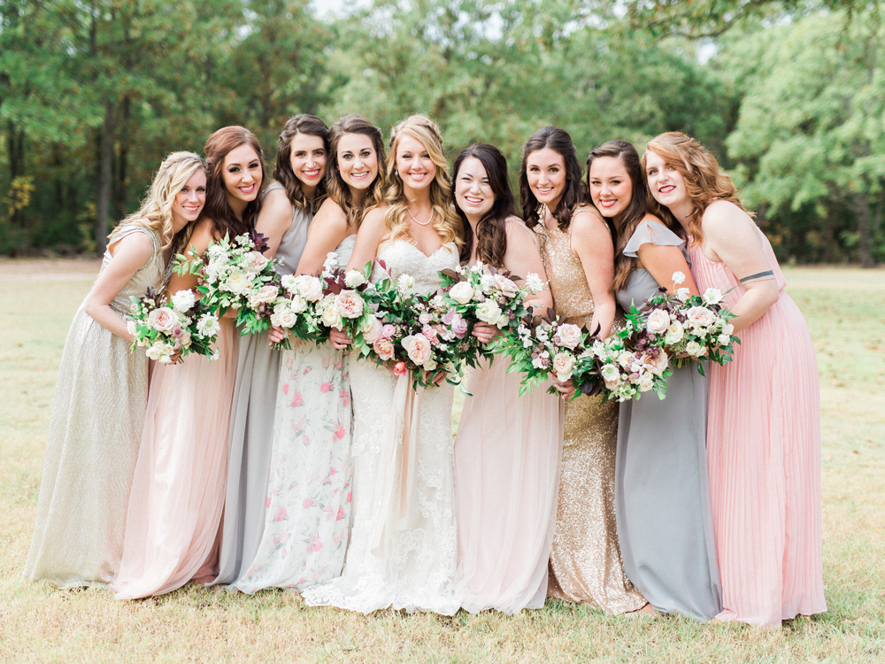 bridesmaids in mismatched dresses - photo by Elisabeth Carol Photography https://ruffledblog.com/picturesque-garden-wedding-at-white-sparrow-barn