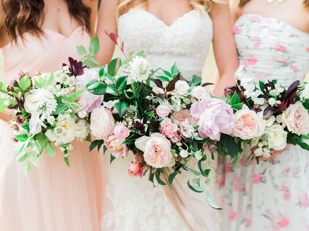bridesmaid bouquets - photo by Elisabeth Carol Photography http://ruffledblog.com/picturesque-garden-wedding-at-white-sparrow-barn