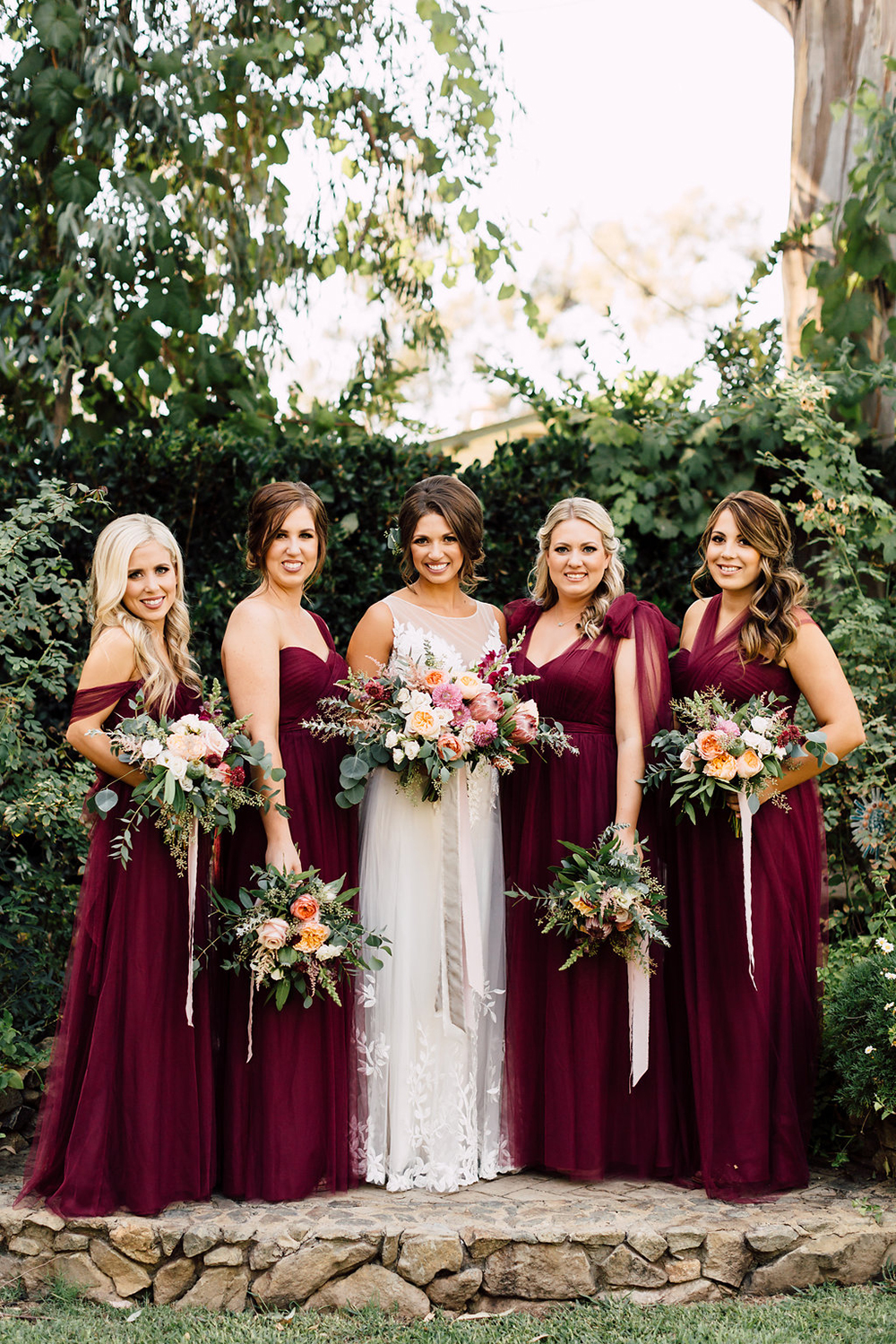burgundy bridesmaid dresses - 20 of our Most Pinned Weddings - photo by Plum and Oak https://ruffledblog.com/20-of-our-most-pinned-weddings