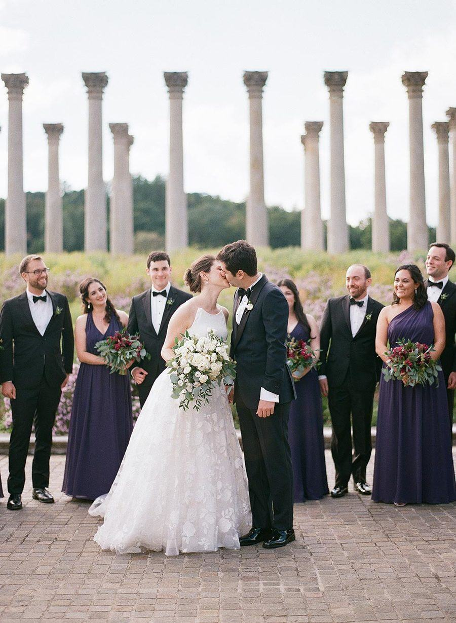 flutter wedding dress with black groom tuxedo at a national arboretum wedding ceremony