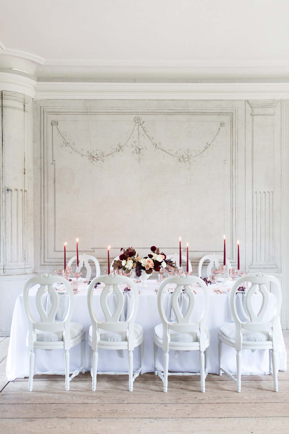 manor wedding reception table with white dior chairs and marsala candles