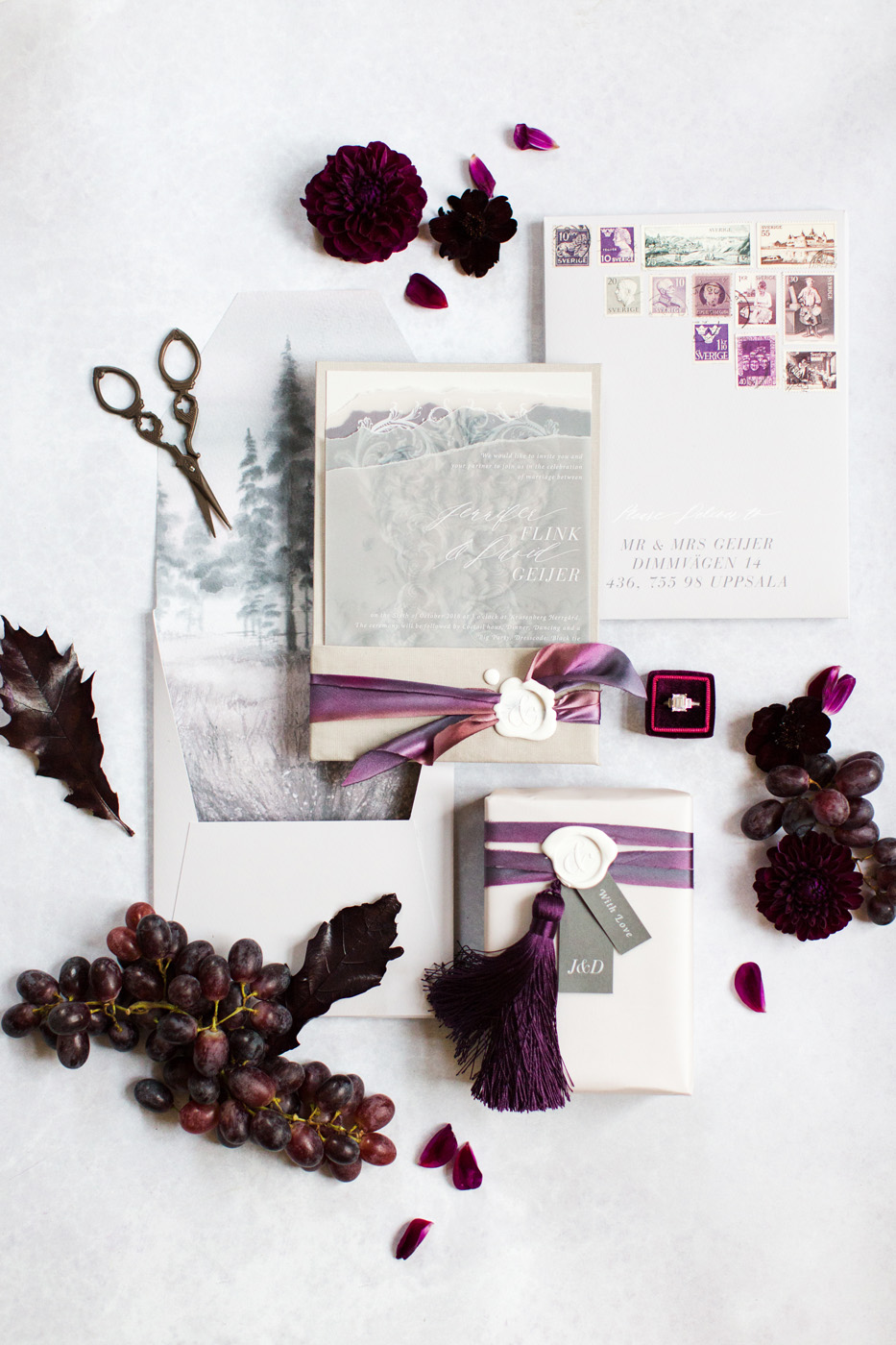 elegant plum invitation suite with white wax seals and tassels