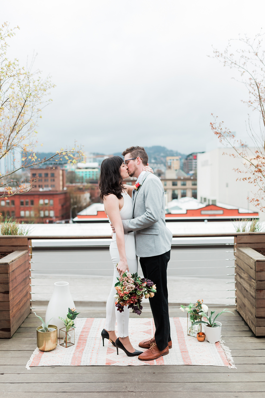 ceremony kiss - photo by Gina Neal Photography https://ruffledblog.com/portland-coffee-lovers-elopement-inspiration
