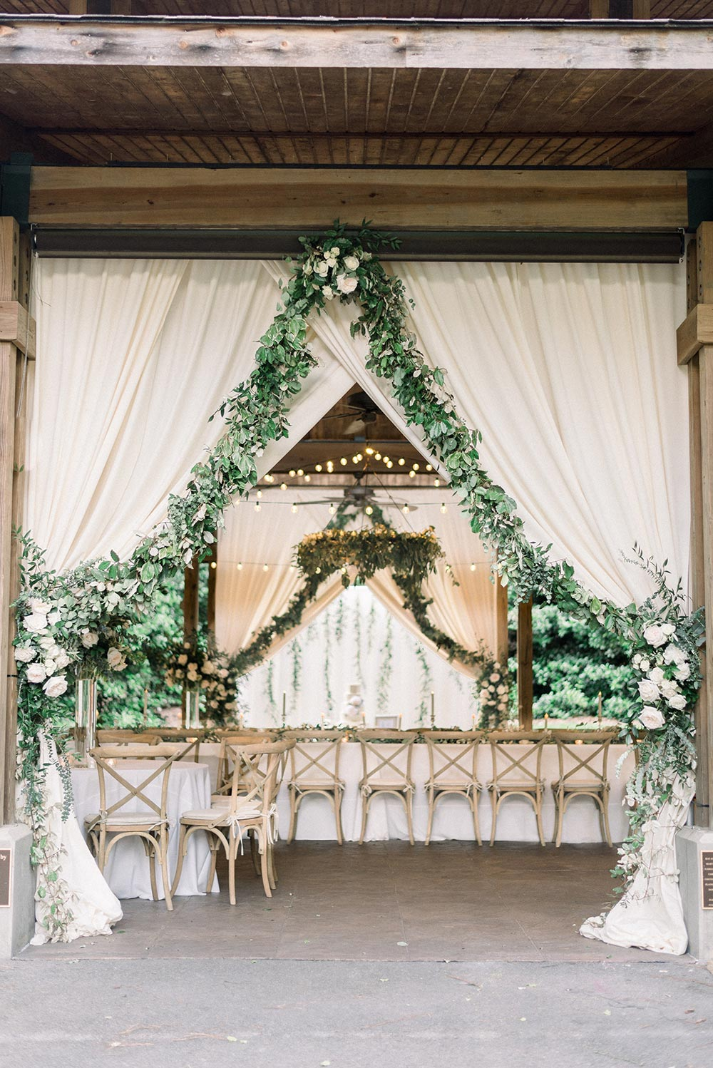 rustic chic wedding reception with greenery