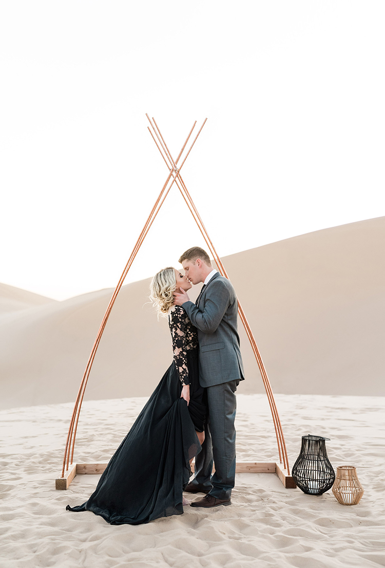Real Sand Dunes Elopement with a Black Wedding Gown - photo by Saje Photography https://ruffledblog.com/real-sand-dunes-elopement-with-a-black-wedding-gown