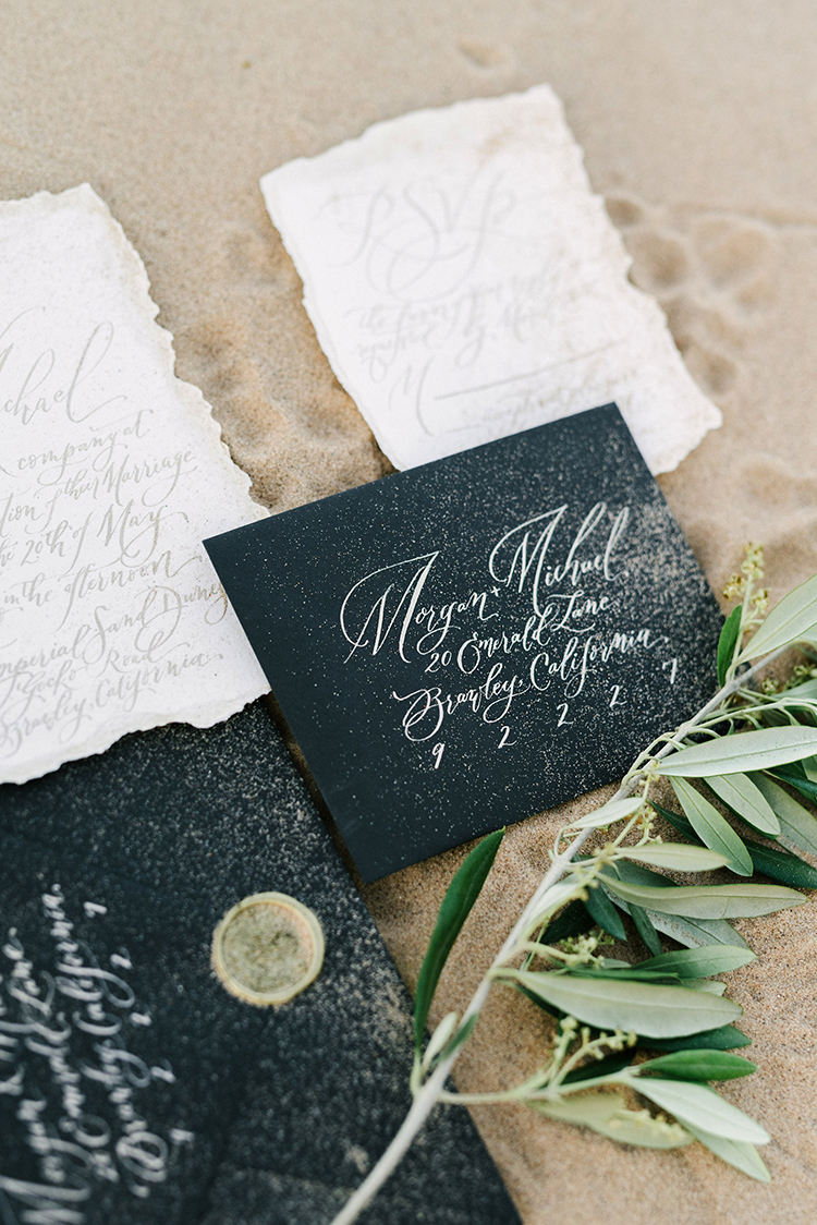 black and ivory wedding invitations - photo by Saje Photography https://ruffledblog.com/real-sand-dunes-elopement-with-a-black-wedding-gown