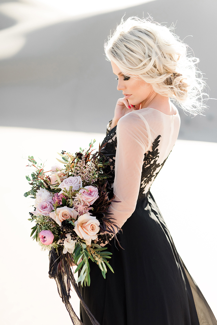 romantic wedding style with a black gown - photo by Saje Photography http://ruffledblog.com/real-sand-dunes-elopement-with-a-black-wedding-gown