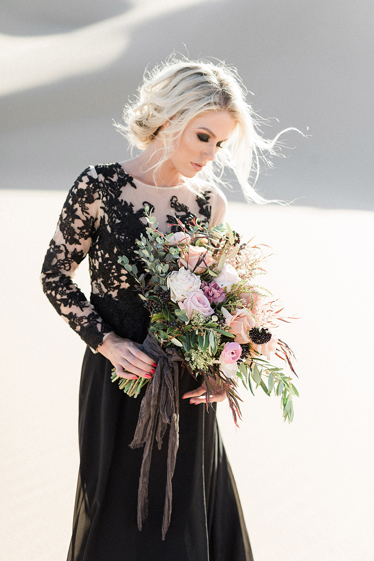 dusty wedding bouquets - photo by Saje Photography https://ruffledblog.com/real-sand-dunes-elopement-with-a-black-wedding-gown