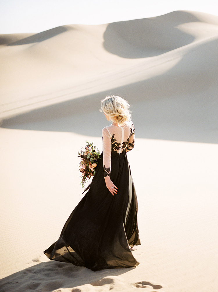 black lace wedding gowns - photo by Saje Photography https://ruffledblog.com/real-sand-dunes-elopement-with-a-black-wedding-gown