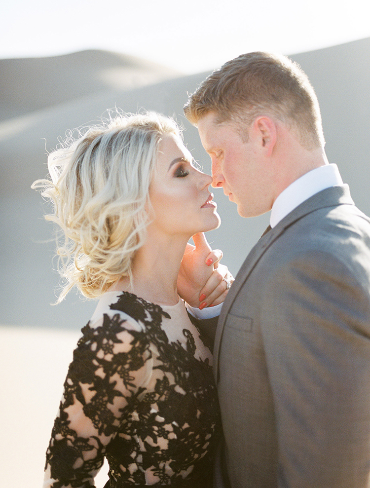 romantic wedding portraits - photo by Saje Photography http://ruffledblog.com/real-sand-dunes-elopement-with-a-black-wedding-gown