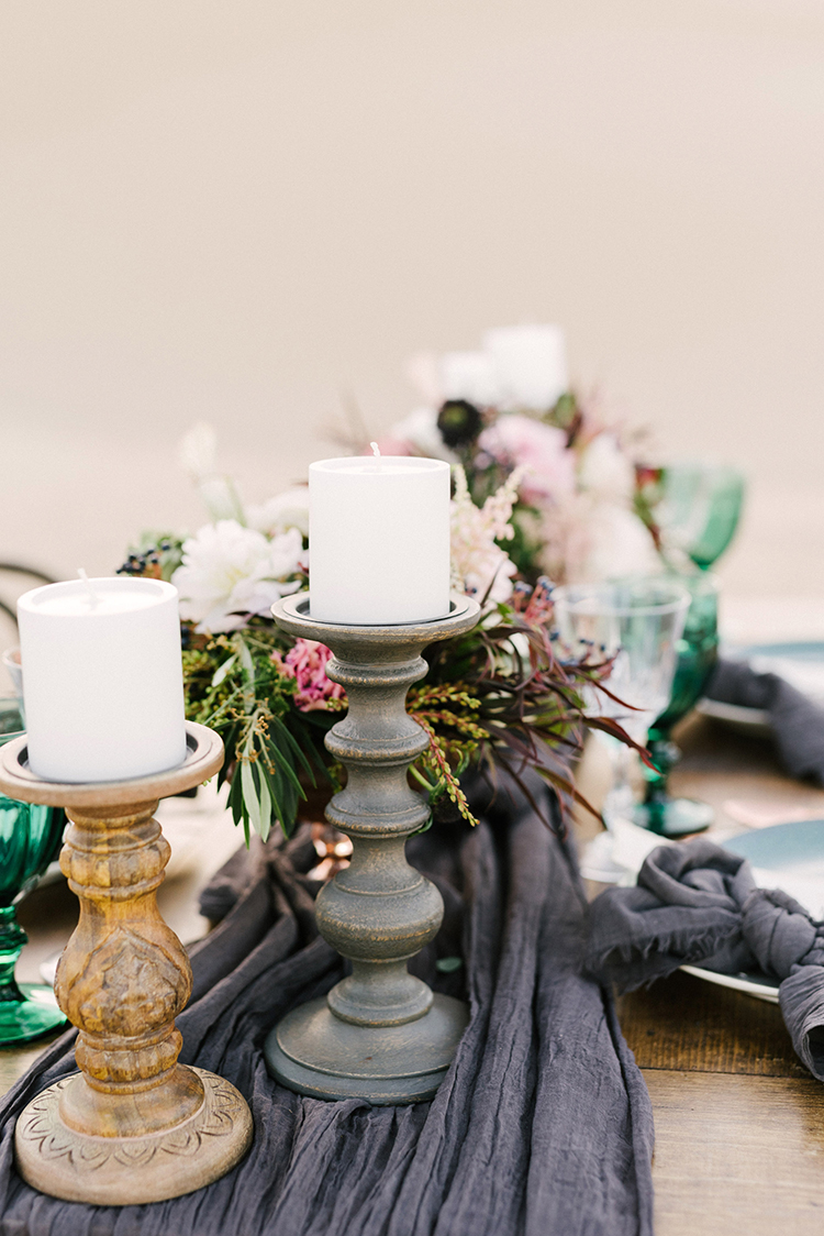 wedding centerpieces with candlesticks - photo by Saje Photography http://ruffledblog.com/real-sand-dunes-elopement-with-a-black-wedding-gown