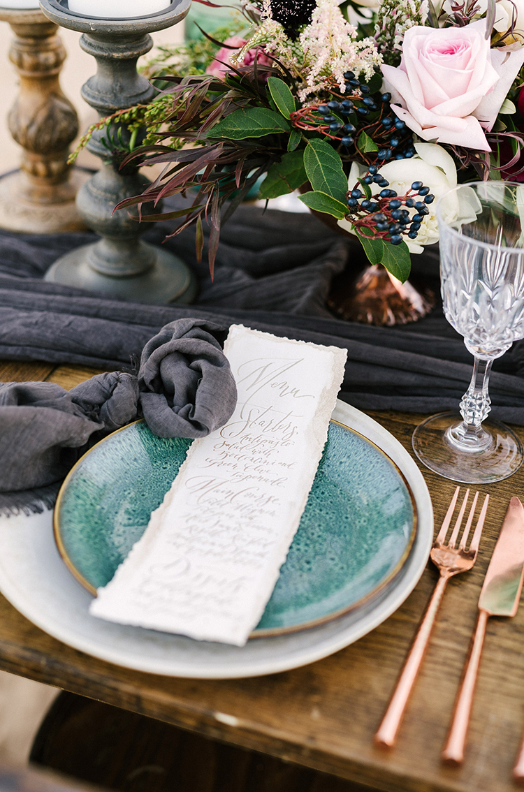 romantic desert inspired place settings - photo by Saje Photography https://ruffledblog.com/real-sand-dunes-elopement-with-a-black-wedding-gown