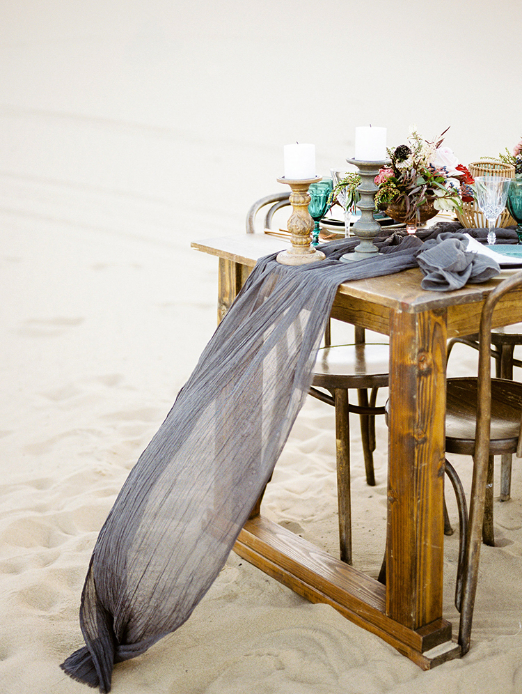 gauze table runners - photo by Saje Photography https://ruffledblog.com/real-sand-dunes-elopement-with-a-black-wedding-gown