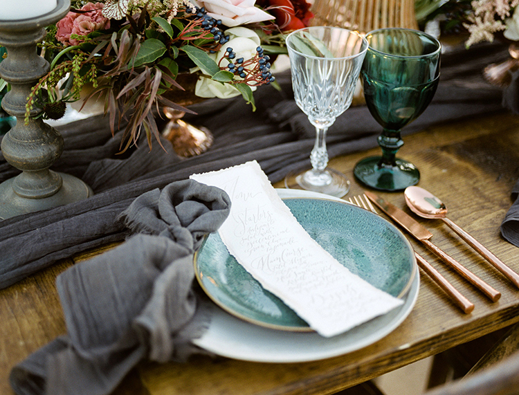 wedding tablescapes with teal accents - photo by Saje Photography http://ruffledblog.com/real-sand-dunes-elopement-with-a-black-wedding-gown