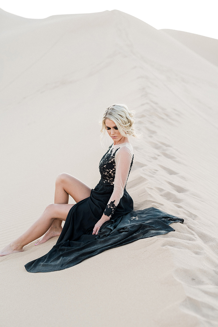 desert wedding inspiration - photo by Saje Photography https://ruffledblog.com/real-sand-dunes-elopement-with-a-black-wedding-gown