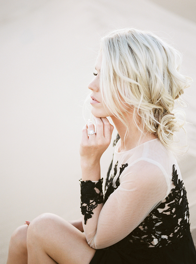 wedding hair with waves - photo by Saje Photography http://ruffledblog.com/real-sand-dunes-elopement-with-a-black-wedding-gown