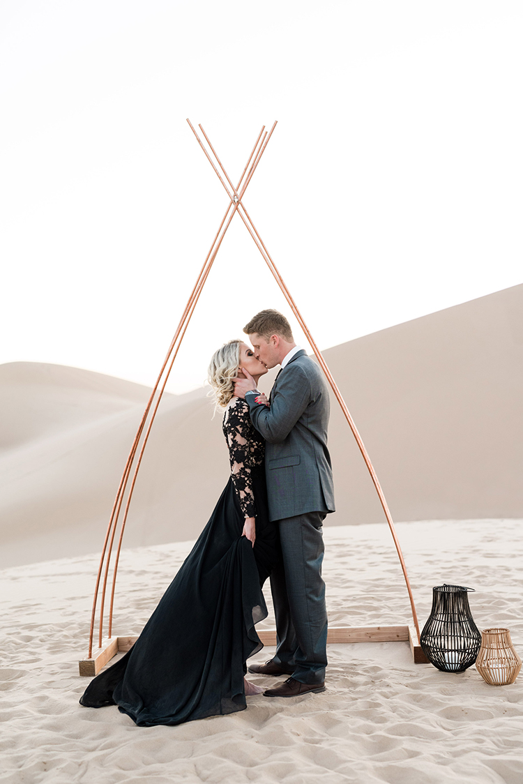 wedding ceremonies - photo by Saje Photography https://ruffledblog.com/real-sand-dunes-elopement-with-a-black-wedding-gown