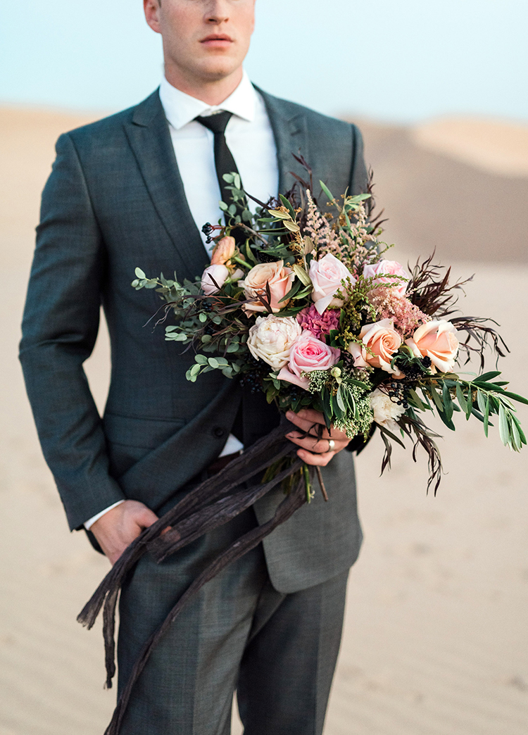 desert wedding bouquets - photo by Saje Photography https://ruffledblog.com/real-sand-dunes-elopement-with-a-black-wedding-gown