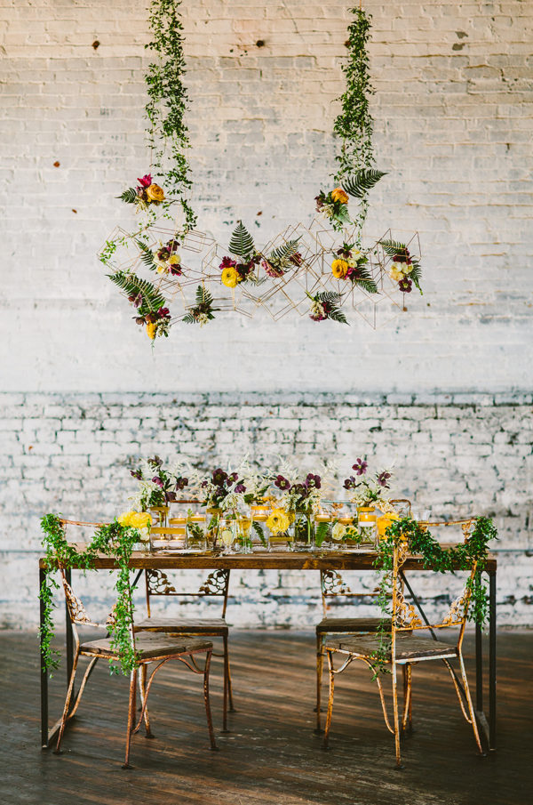 geometric hanging chandeliers - photo by Redfield Photography http://ruffledblog.com/40-eye-catching-geometric-wedding-ideas