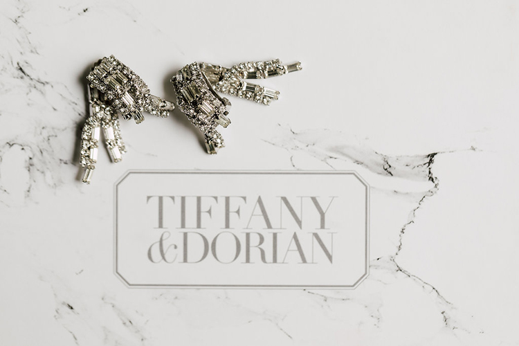 wedding jewelry - photo by Purple Tree Photography http://ruffledblog.com/refined-wedding-ideas-with-a-monochrome-palette