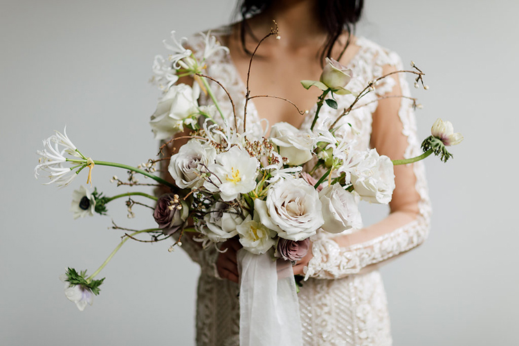 wedding bouquets - photo by Purple Tree Photography http://ruffledblog.com/refined-wedding-ideas-with-a-monochrome-palette