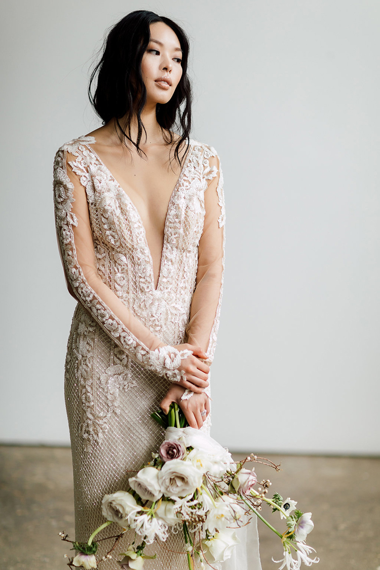 unique wedding dresses - photo by Purple Tree Photography http://ruffledblog.com/refined-wedding-ideas-with-a-monochrome-palette