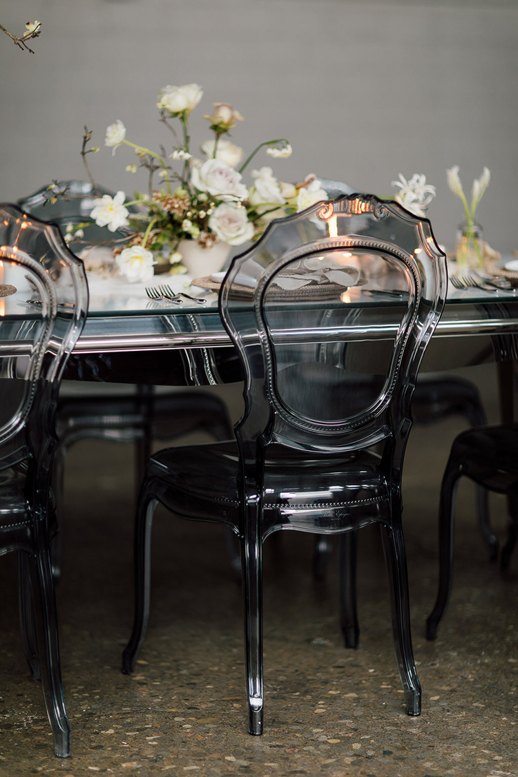 ghost chairs - photo by Purple Tree Photography http://ruffledblog.com/refined-wedding-ideas-with-a-monochrome-palette