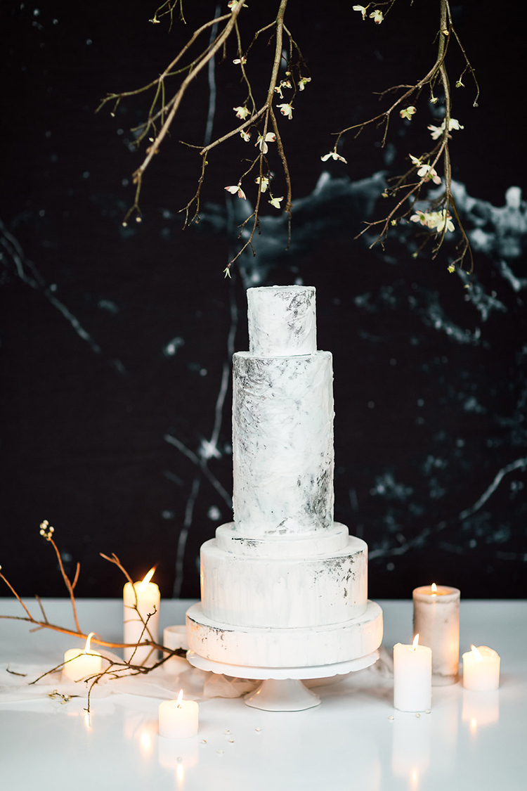 unique tall wedding cakes - photo by Purple Tree Photography http://ruffledblog.com/refined-wedding-ideas-with-a-monochrome-palette