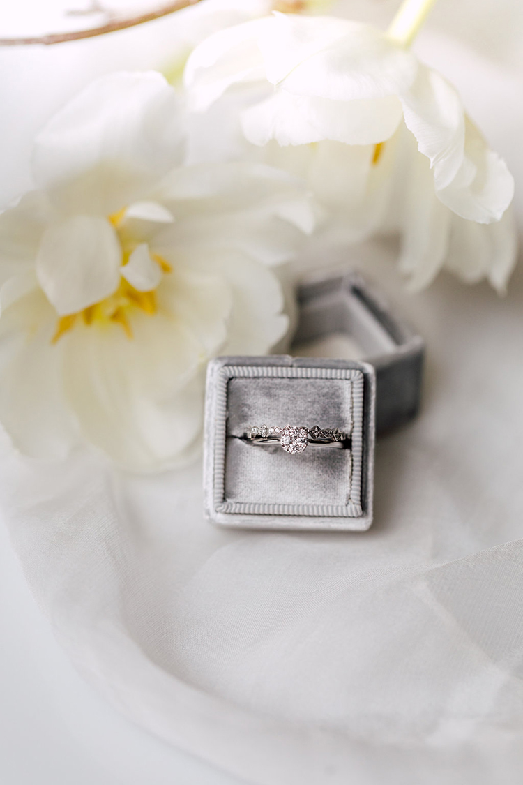 wedding rings - photo by Purple Tree Photography http://ruffledblog.com/refined-wedding-ideas-with-a-monochrome-palette