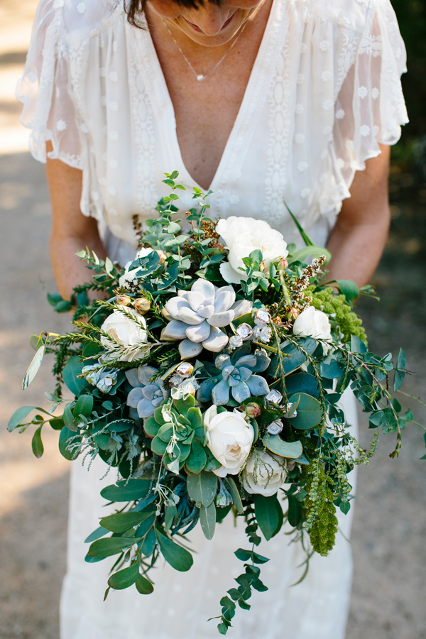 eucalyptus and succulent bouquet - photo by Love Katie and Sarah https://ruffledblog.com/relaxed-backyard-australian-wedding