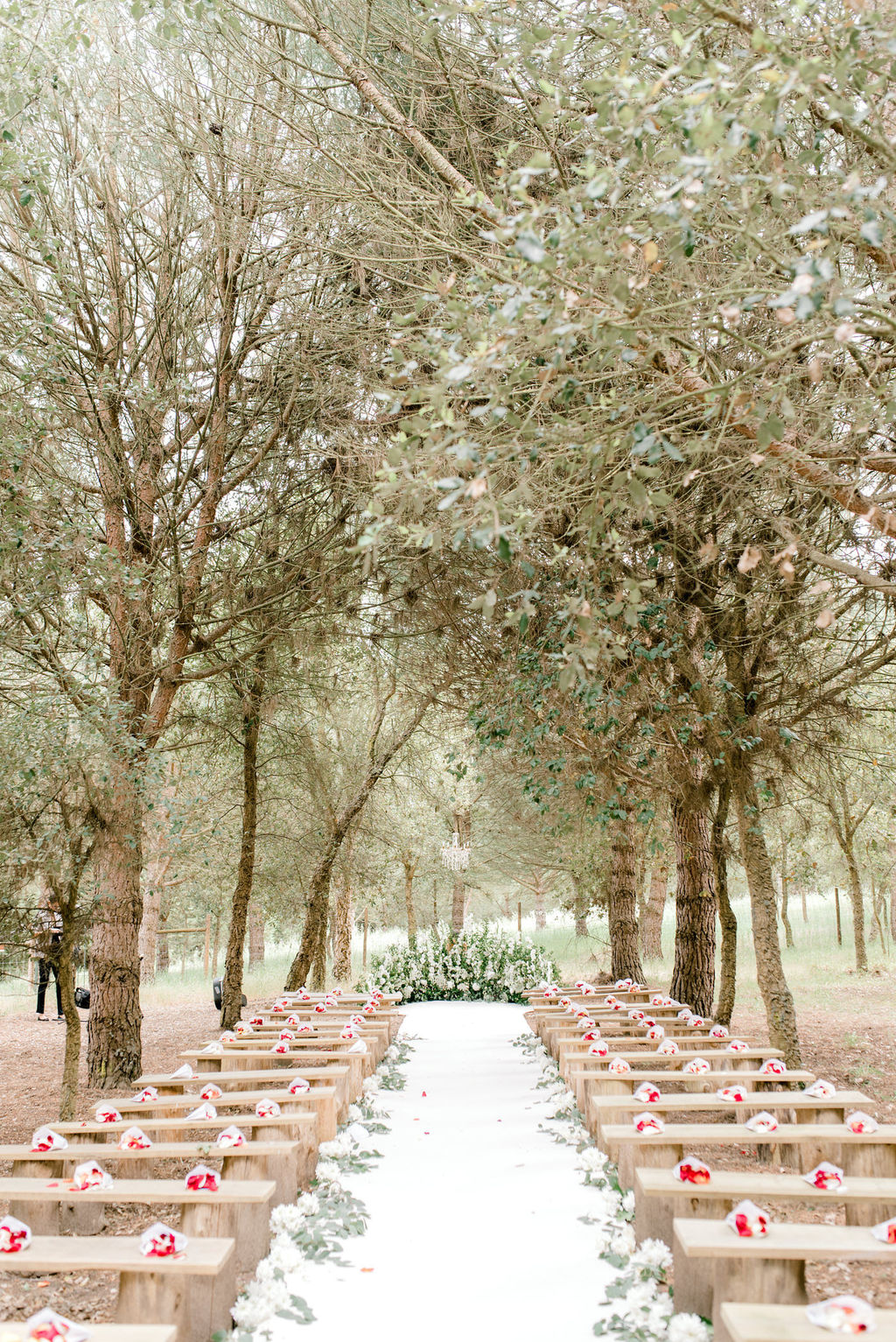 classic forest wedding with floral crescent wedding ceremony backdrop