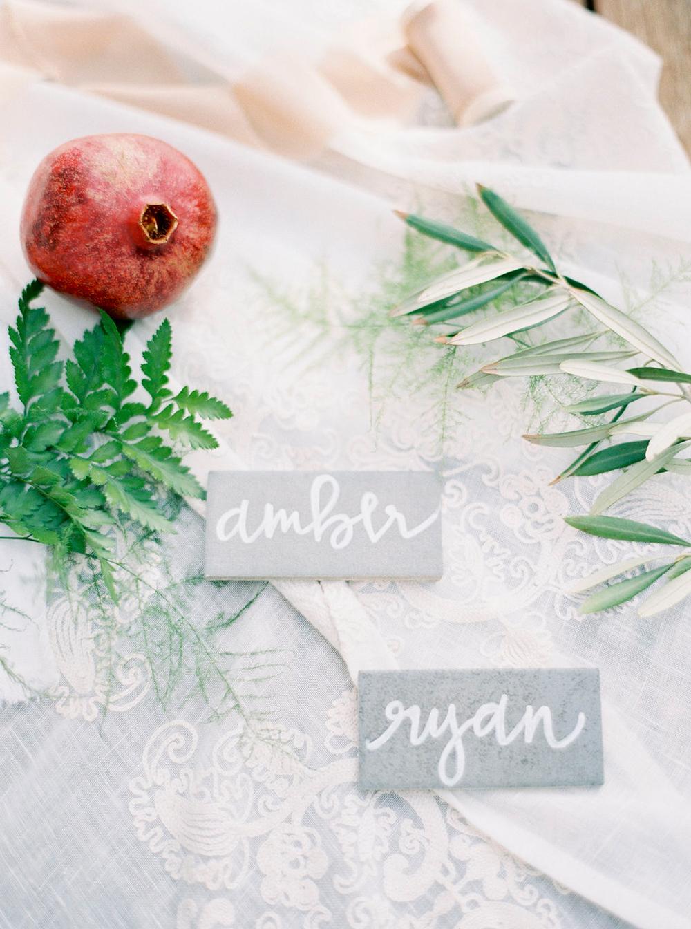 grey name cards - photo by Amanda Lenhardt http://ruffledblog.com/relaxed-san-juan-capistrano-wedding-inspiration