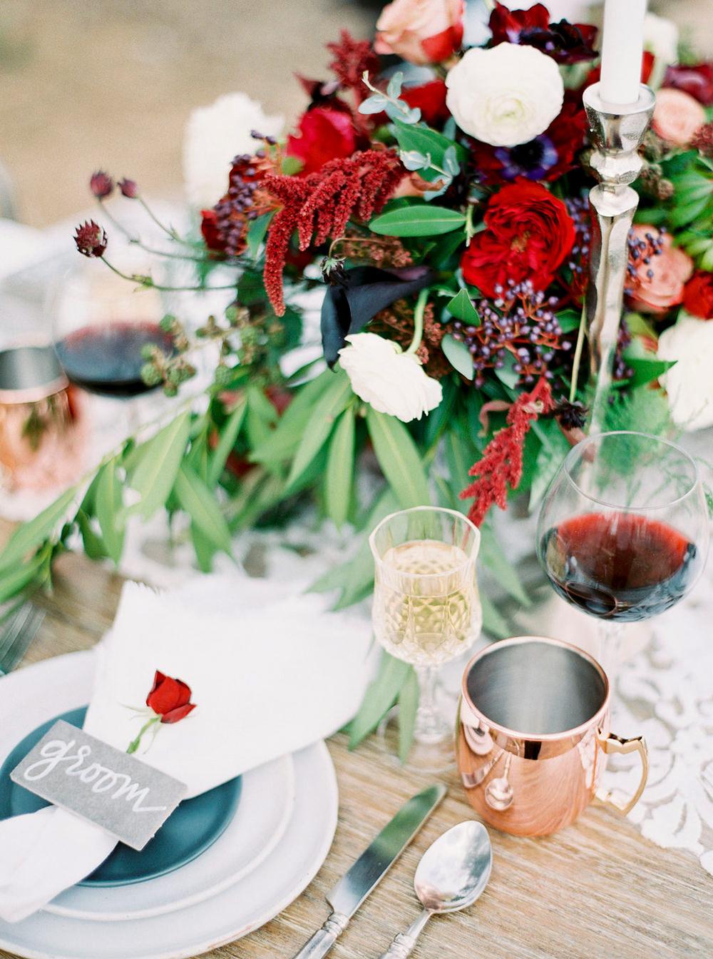 romantic red and green centerpieces - photo by Amanda Lenhardt https://ruffledblog.com/relaxed-san-juan-capistrano-wedding-inspiration