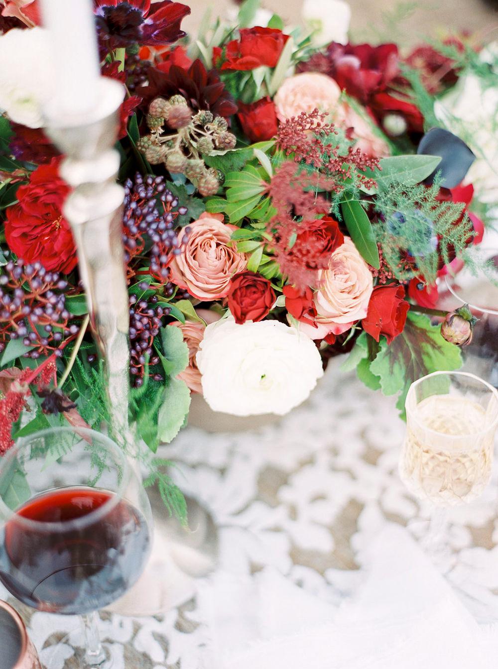 red and green centerpieces - photo by Amanda Lenhardt https://ruffledblog.com/relaxed-san-juan-capistrano-wedding-inspiration
