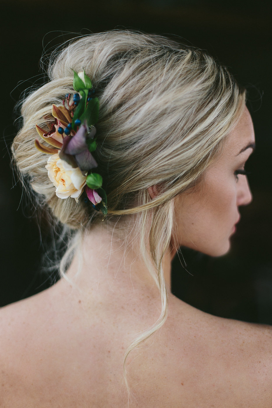 wedding hair with flowers - photo by Hannah Victoria Photography https://ruffledblog.com/rich-toned-industrial-wedding-inspiration