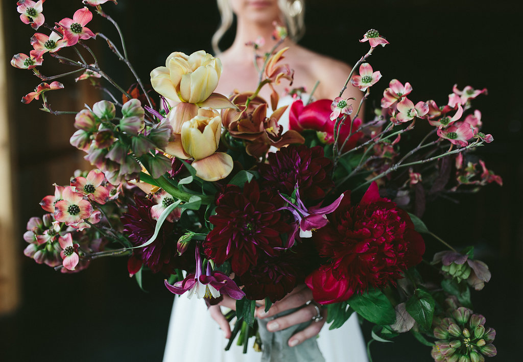 wedding flowers - photo by Hannah Victoria Photography http://ruffledblog.com/rich-toned-industrial-wedding-inspiration