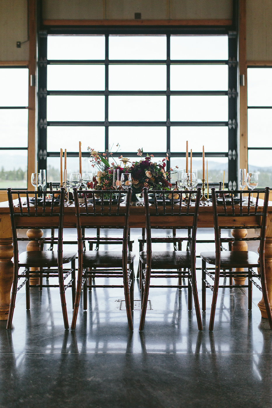 wedding reception tables - photo by Hannah Victoria Photography http://ruffledblog.com/rich-toned-industrial-wedding-inspiration