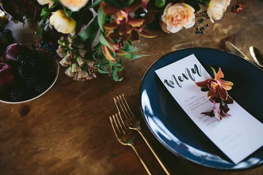 table settings - photo by Hannah Victoria Photography https://ruffledblog.com/rich-toned-industrial-wedding-inspiration