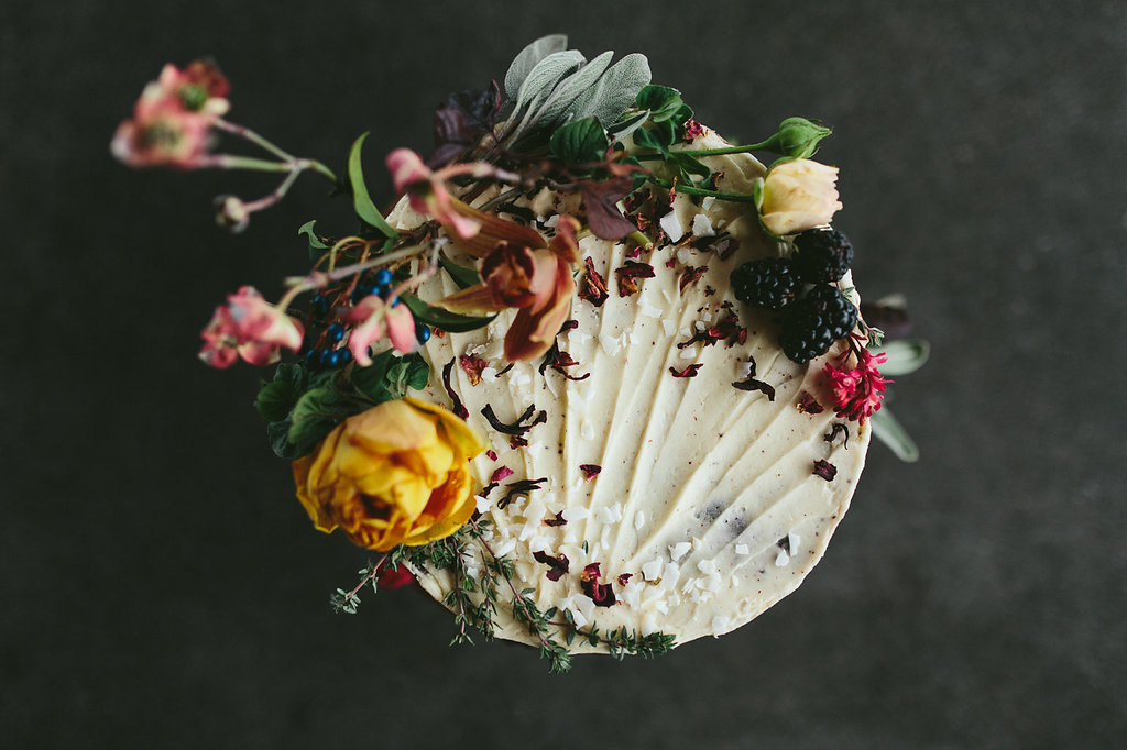 wedding cakes with flowers - photo by Hannah Victoria Photography http://ruffledblog.com/rich-toned-industrial-wedding-inspiration